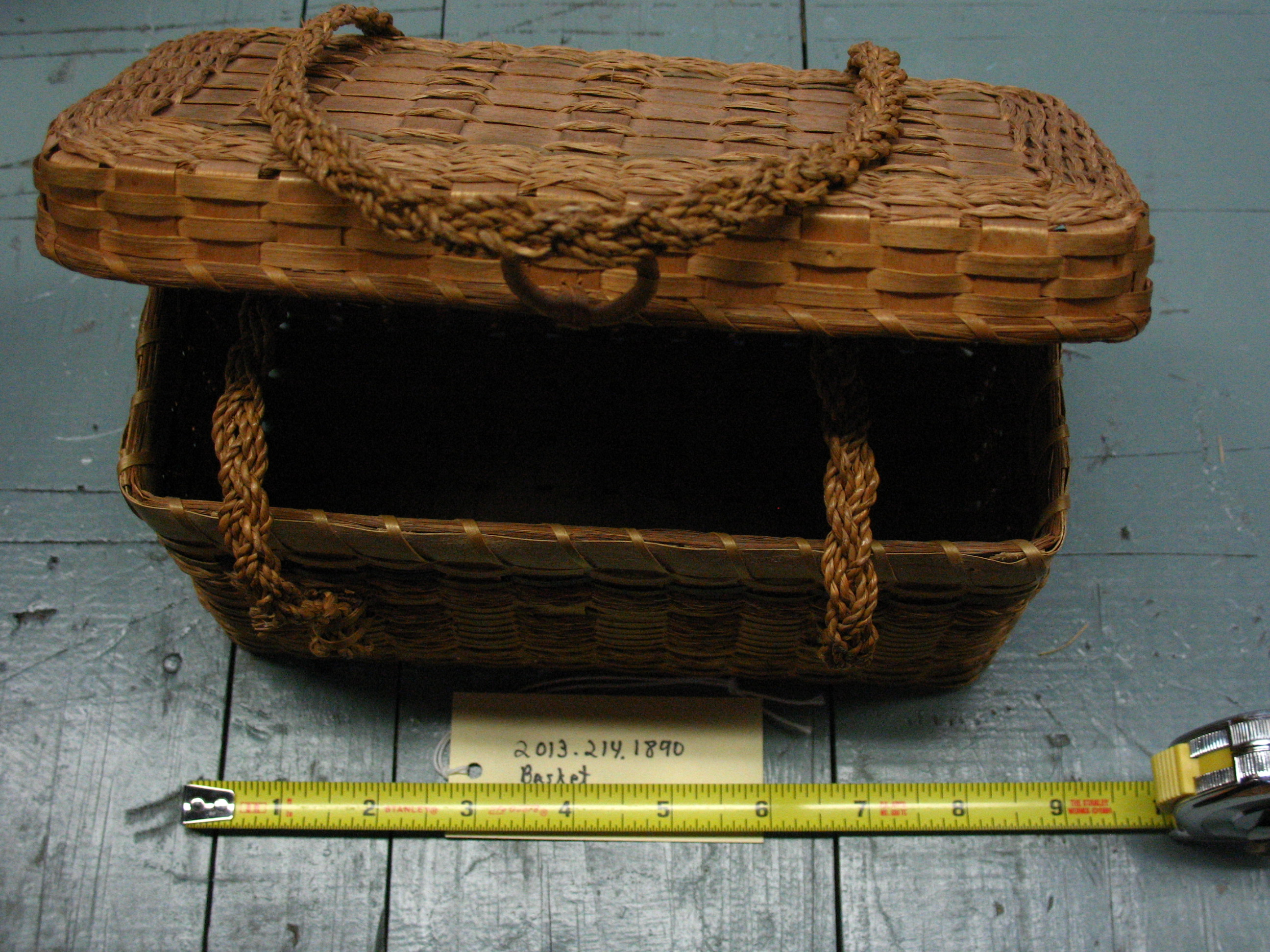 Native American sweetgrass basket with lid